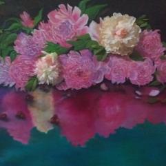 انعكاس الورد على سطح الماء