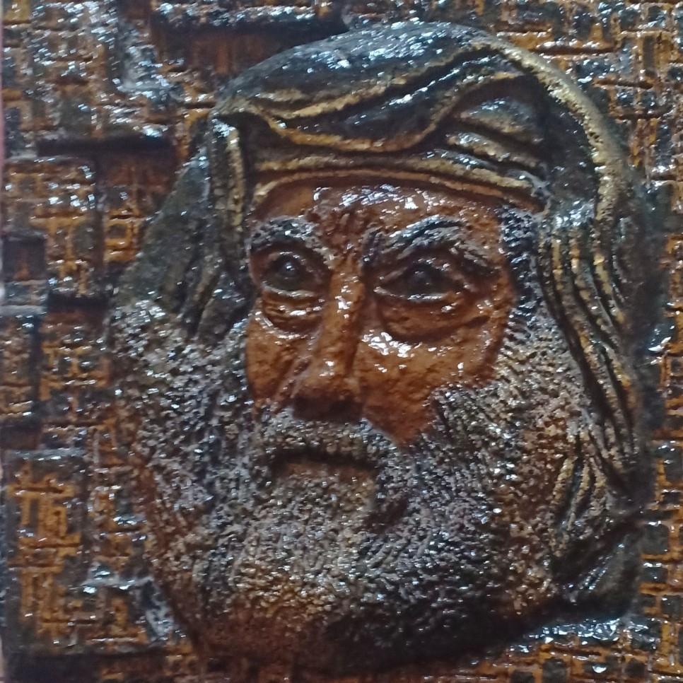 البابا كيرلس .. وجه مجسم منفذ بالرمل